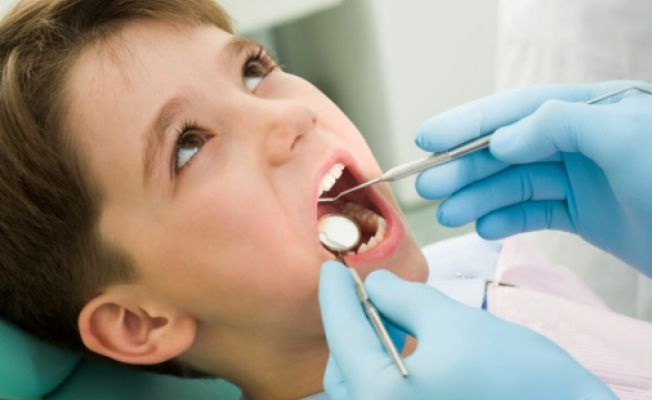 ребенок на приеме стоматолога