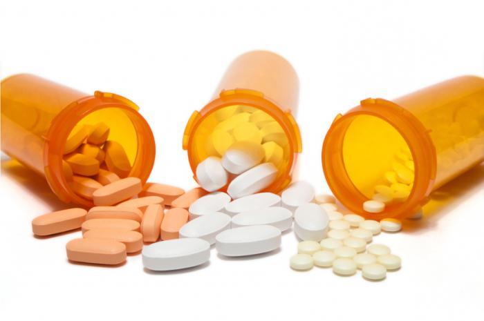 таблетки в оранжевых капсулах